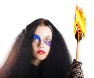 Staring woman holding torch Royalty Free Stock Photos