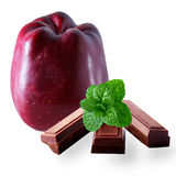 Stark delicious apple with mint and dark chocolate. On white background stock images