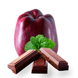 Stark delicious apple with mintand chocolate. Stark delicious apple with mint and chocolate on white background royalty free stock photo