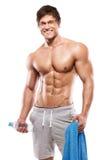 Stark idrotts- man som visar stor biceps och buk- muskler royaltyfri fotografi