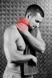 Stark konditionmankänsla smärtar Arkivbild