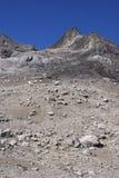 Stark rocky peaks against blue sky Stock Photo
