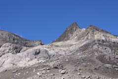 Stark rocky peaks against blue sky Royalty Free Stock Image