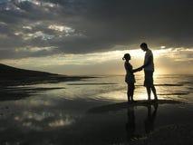 Stark Romance. Romantic evening scene at the beach royalty free stock photos