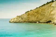 Stark sea cliff slanting to Mediterranean sea Stock Photography