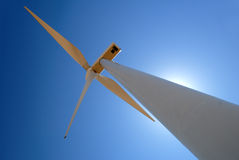 Stark White Power Generating Windmill Stock Image