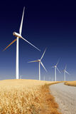 Stark White Power Generating Windmills Stock Photo