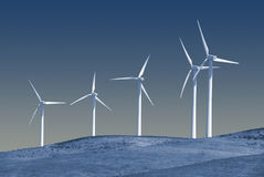 Stark White Power Generating Windmills Stock Photos
