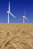 Stark White Power Generating Windmills Royalty Free Stock Images