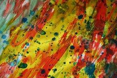 Starka livliga driftiga guld- fläckar för vattenfärg för fläcktexturmålarfärg Arkivfoto