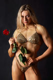 Starke Frau mit einer Rose Lizenzfreies Stockbild