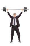 Starker Geschäftsmann, der ein Schwergewicht anhebt Lizenzfreies Stockfoto