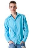 Starker Kerl mit seiner Bluse Stockfotografie