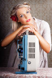 Starlet Recalling Classic Fifties Cinema Stardom. Beautiful Glamorous Young Blonde Starlet Leaning On Top Of An Old Reel To Reel Cine Projector With A Dreamy Stock Photos