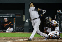 Starlin Castro Swings Hard Royaltyfri Bild