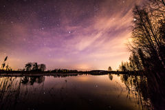 Starlit sky reflecting. Beautiful spring night and starlit sky by the river. Fascinating colors appeared in the sky Royalty Free Stock Photo