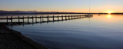 Starnberg lake and boardwalk at sunset Stock Image