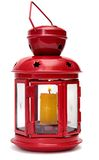 Czerwona metal lampa z świeczką. Fotografia Royalty Free