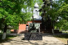 Monument in honor of victory in the Second World War. An artillery cannon and a building with pots of earth from battle sites. stock images