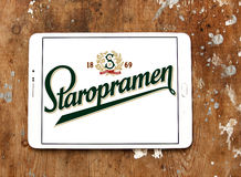 Staropramen beer logo. Logo of beer drinks company staropramen on samsung tablet on wooden background Royalty Free Stock Images