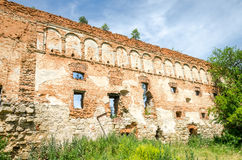 Staroselskiy castle in Stare Selo in the Lviv. The old ruins of the collapsed walls with gates and windows Staroselskiy castle in Stare Selo in the Lviv region royalty free stock photo