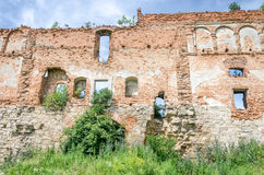 Staroselskiy castle in Stare Selo in the Lviv. The old ruins of the collapsed walls with gates and windows Staroselskiy castle in Stare Selo in the Lviv region royalty free stock images