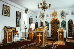 Interior of the Orthodox Church. STAROSILLIA, UKRAINE - 4 February 2009: Interior of the Orthodox Church, altar, iconostasis and painted icons royalty free stock images