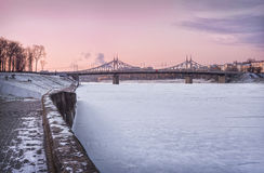 Starovolzhsky bridge. Under sunset pink sky Royalty Free Stock Photo