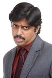 Starring with angry Indian business man portrait Royalty Free Stock Photos