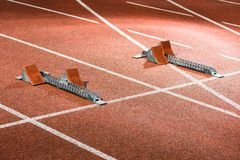 Starrting blocks at cindertrack of athletics stadium Stock Photography