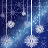 Starry. Decorative snowflakes at the glittering starry background Royalty Free Stock Photography