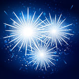 Starry fireworks on blue background. Vector Stock Images
