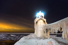Starry, Frigid Night at St. Joseph Lighthouse. Stars shine brightly over this night time photo of St. Joseph Lighthouse in St. Joseph Michigan. The light is Stock Photo