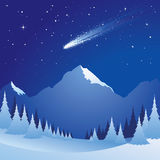 Starry night. Falling stars over the snowy mountains Stock Images