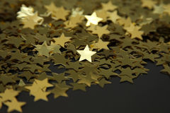 Starry night. Golden star shining on a background of stars Stock Photography