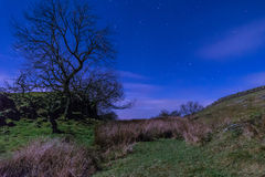 Starry Night above Hadrians Wall. Moonlit Hadrians Wall is in the recently awarded Dark Sky Park in Northumberland Stock Photography