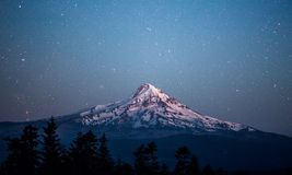 Starry night above Mt Hood. Royalty Free Stock Image