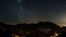 Starry night on countryside time lapse. Stars moving in sky with milky way galaxy. stock video footage