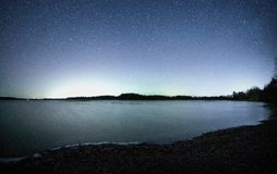 Starry night at lake Stock Images