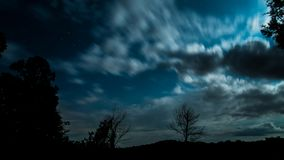 Starry night landscape with clouds Royalty Free Stock Photo
