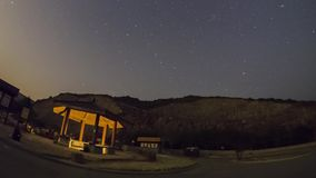 Starry night and moonrise timelapse stock video footage