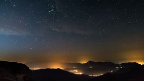 Starry night in mountains time lapse. Stars moving over countryside. Night to day shot. Time lapse video of peaceful summer night with millions stars moving over stock video