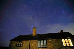 Starry night. Old stone house in East Devon at starry night Stock Photo