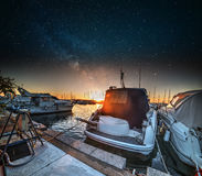 Starry night over Alghero harbor Stock Image