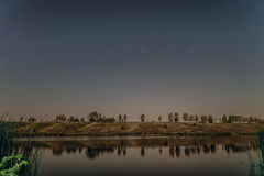 Starry night over the lake Stock Photography