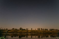 Starry night over the lake Stock Image