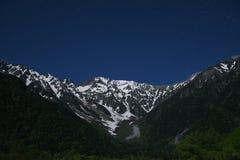 Starry night over mountain Stock Photos