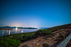 Starry night over Porto Conte bay Royalty Free Stock Image