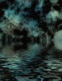 Starry Night Over Water. Starry night with dark clouds reflected over water Royalty Free Stock Photography