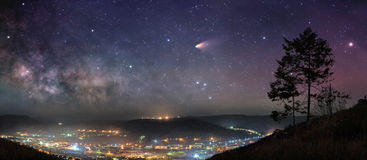 Starry night panorama. Panoramic picture of starry night sky over mountain town Royalty Free Stock Photo